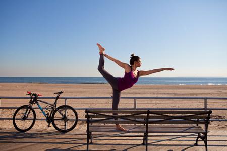 seaboard: Woman in yoga pose on promenade