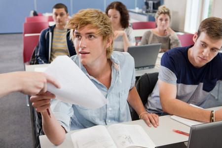 further: University student receiving exam paper