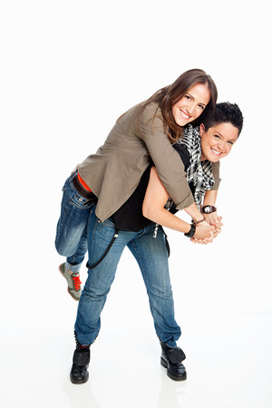 female sexuality: Lesbian couple standing against white background