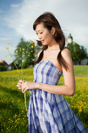 made in germany: Woman with wild flowers, Bavaria, Germany LANG_EVOIMAGES