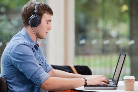 higher intelligence: University student working on laptop