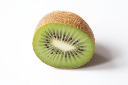 Half a kiwi on white background