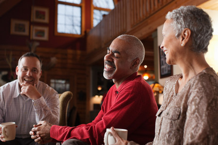 45 50 years: Mature friends laughing together in living room