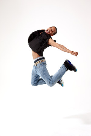 Jubilant young man in mid air LANG_EVOIMAGES