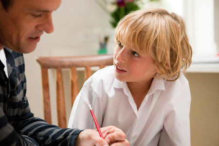 30 years old man: Father helping son with homework LANG_EVOIMAGES