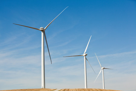 high winds: Three wind turbines side by side
