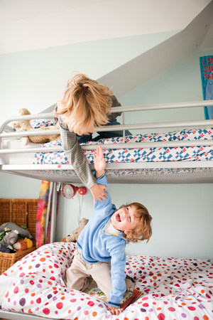 bunkbed: Young boys playfighting on their bunk bed LANG_EVOIMAGES
