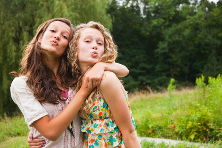puckered: Teenage girls fooling around and puckering lips