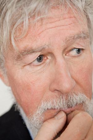 60 65 years: Senior man looking worried LANG_EVOIMAGES