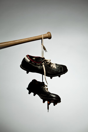 go inside: Shoes hanging from baseball bat