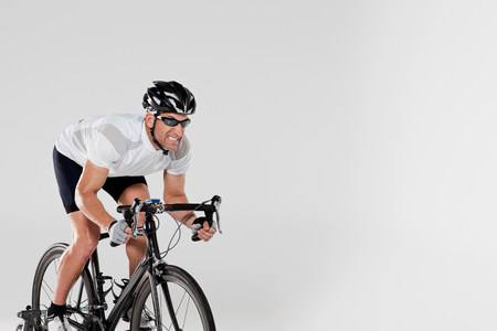 enraged: Determined male cyclist