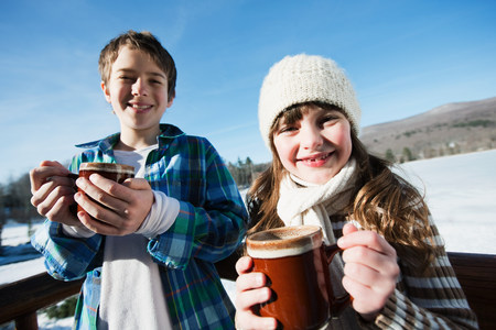 pastoral scenery: Children with hot drinks, portrait LANG_EVOIMAGES