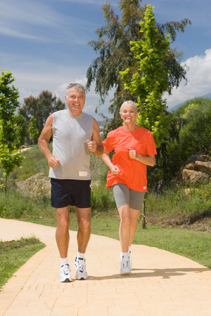 energy work: Mature couple jogging together