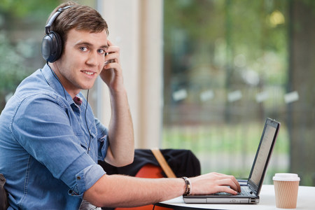 University student working on laptop, portrait