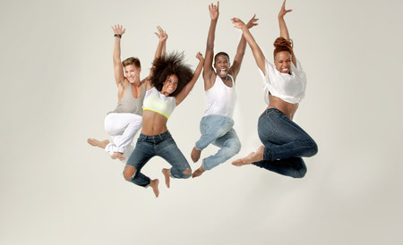 Four young adults jumping in the air with joy LANG_EVOIMAGES