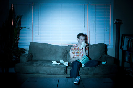 silliness: Young man watching tv, crying