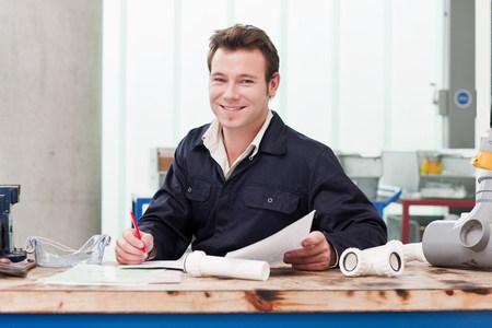 Apprentice plumber in class, portrait LANG_EVOIMAGES
