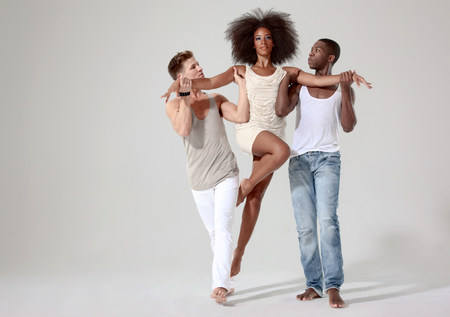 gifted: Two men holding a young woman off the ground