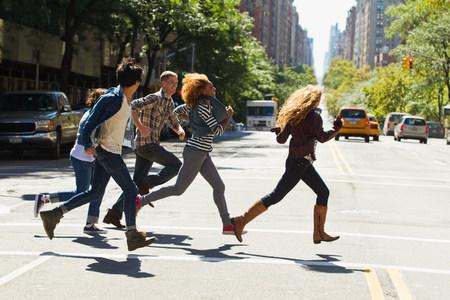 hurried: Five friends running through city street