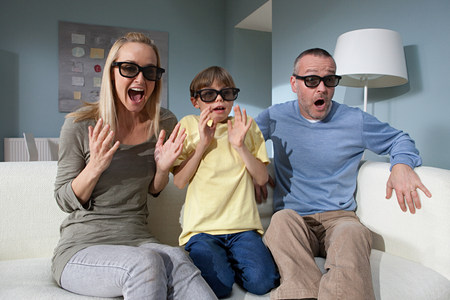 45 50 years: Family watching 3d movie at home