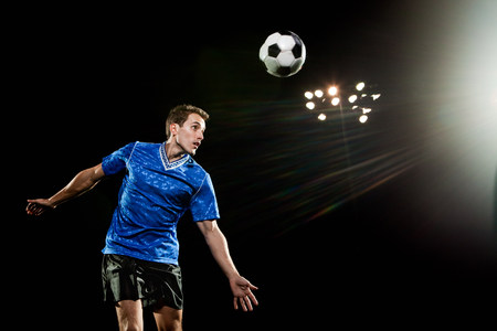 detoxing: Young man leaping to head soccer ball