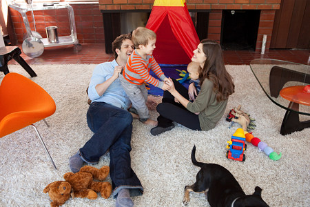 coverings: Family playing in living room