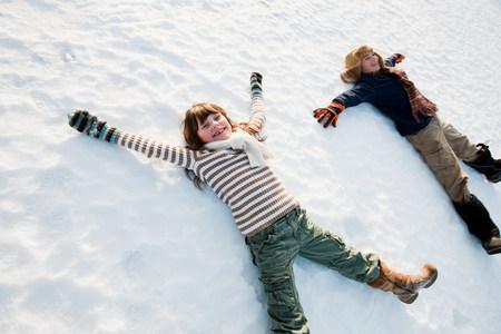 Children making snow angels