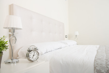 double cross: Bedroom in white with double bed