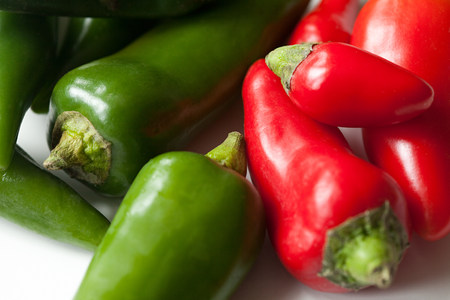 contrasted: Green and red chilli peppers