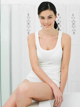 undergarment: Portrait of young woman in bathroom LANG_EVOIMAGES