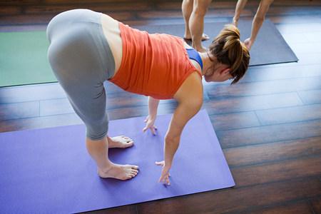 Two women doing yoga class
