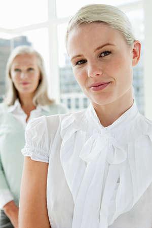 chic woman: Two businesswomen in office, portrait