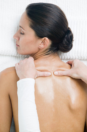 Young woman having shoulder massage