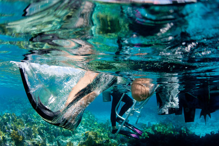 providence: Underwater view of giant stride LANG_EVOIMAGES