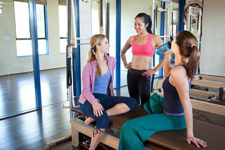 above 18: Three women in gym talking