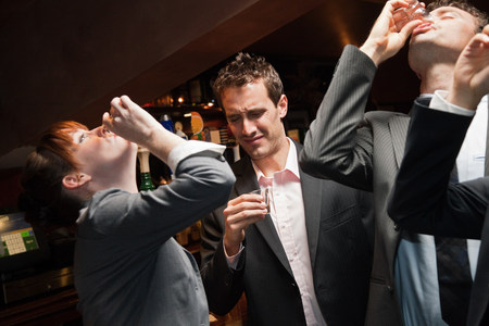 revulsion: Businesspeople drinking at a bar