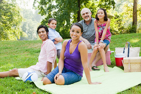medium body: Three generation family at picnic in park, portrait