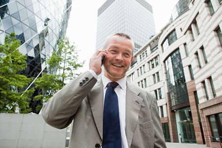 30 st mary axe: Businessman in city on cellphone