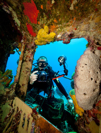 submerging: Underwater photographer on wreck