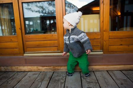 grays: Boy outside wooden chalet