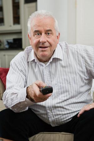 60 64 years: Senior man watching television
