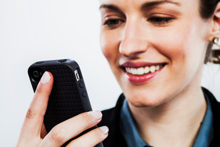 body parts cell phone: Young woman holding smartphone