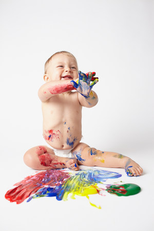 Baby playing with paints