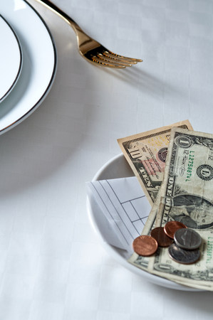endings: Payment on table at restaurant