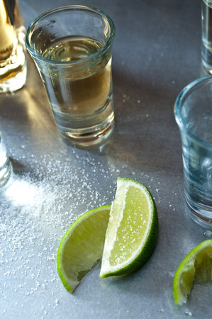 inebriated: Tequila shots with lime wedges LANG_EVOIMAGES