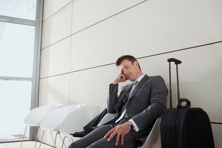 fedup: Businessman with luggage,sleeping LANG_EVOIMAGES