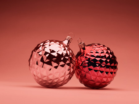 reflective: Pink and red Christmas baubles