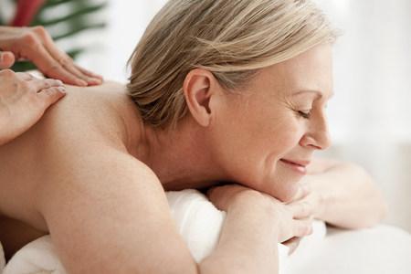 Mature woman receiving massage LANG_EVOIMAGES
