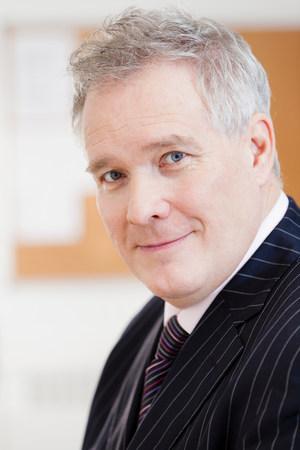 Businessman smiling,portrait
