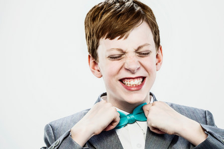exasperation: Boy adjusting bow tie